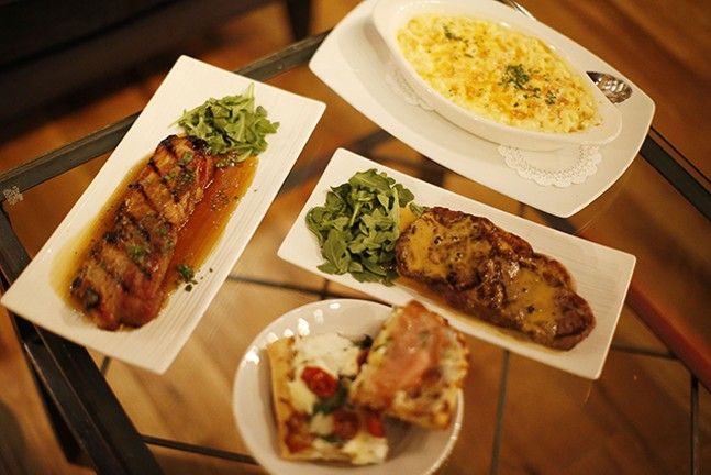 Pork belly, sirloin steak, macaroni and cheese, and an assortment of pizza at PA Market - CP PHOTO: JARED WICKERHAM