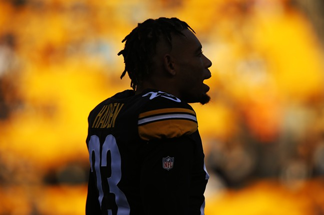 Joe Haden #23 is silhouetted against the setting sun during pregame warmups. - CP PHOTO: JARED WICKERHAM