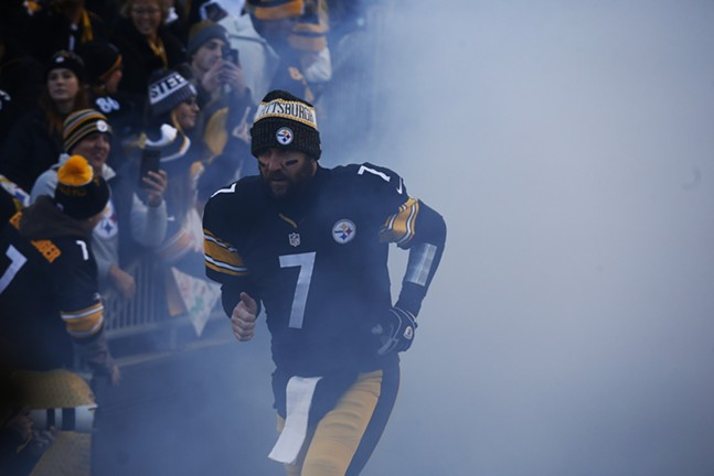 Ben Roethlisberger enters the field amidst the smoke. - CP PHOTO: JARED WICKERHAM