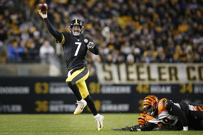 Ben Roethlisberger leaps while throwing a pass. - CP PHOTO: JARED WICKERHAM