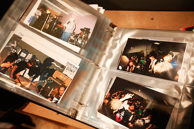 The Mr. Roboto Project has photo albums of past shows on display in its zine library - CP PHOTO: JARED WICKERHAM