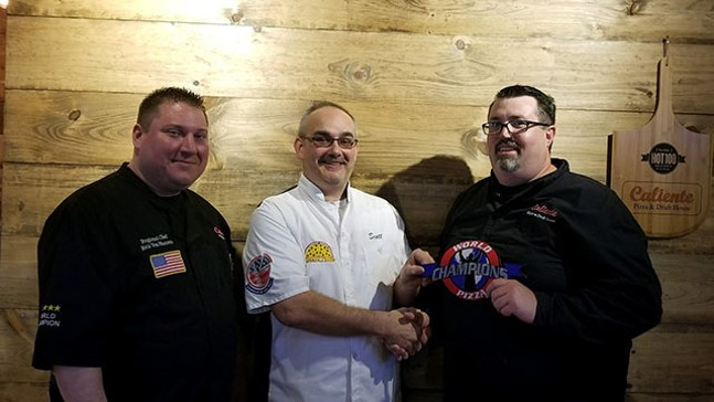 Eric Von Hansen (left) and Nick Bogacz (right) with Scott Anthony (middle), owner of Punxsy Pizza, with the World Pizza Champions patch as a welcome to the team. - PHOTO: CALIENTE PIZZA