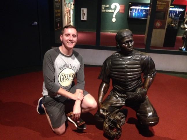 CP senior writer Ryan Deto posing next to Josh Gibson's statue at Negro Leagues Baseball Museum - CP PHOTO: RYAN DETO