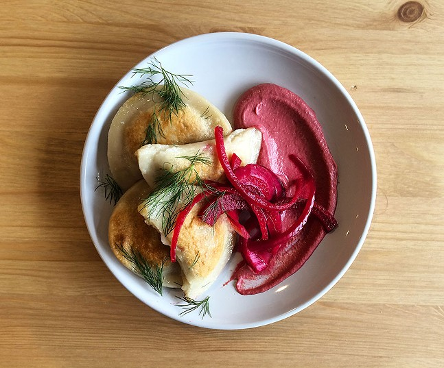 Pierogi, stuffed with potato and caramelized onion and served with pickled veg and beet crema - PHOTO: ABBIGAIL HANSEL, HEAD DINNER CHEF