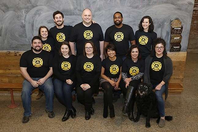 The staff of 412 Food Rescue: From left, first row: Ryan Geraghty, Becca Sufrin, Jen England, Leah Lizarondo, Sara Swaney, and Mel Cronin; Standing from left: Jaclyn Janeczko, Jake Tepperman, Anthony Levin-Decanini, Leland Scales, and Hana Uman; Not pictured: Dan Scullin and Gregg Brunner - CP PHOTO: JARED WICKERHAM
