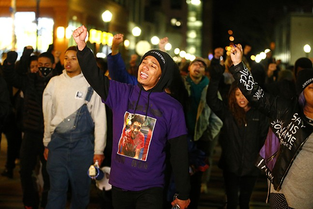 Khalil Darden, 18, of Penn Hills, leads a group of protesters through East Liberty on Fri., March 22 - CP PHOTO: JARED WICKERHAM