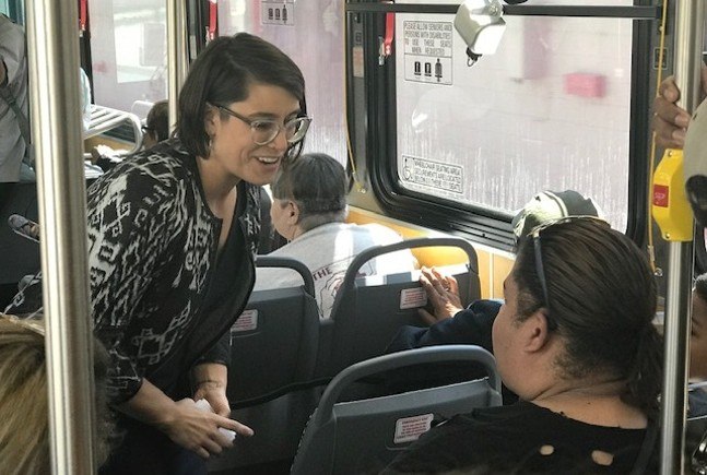 Sara Innamorato talking  to a bus rider during her transit town hall on the 91 bus - CP PHOTO: RYAN DETO