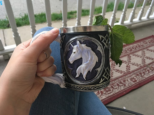 Mint julep in a unicorn mug from the Renaissance Faire - AMANDA WALTZ