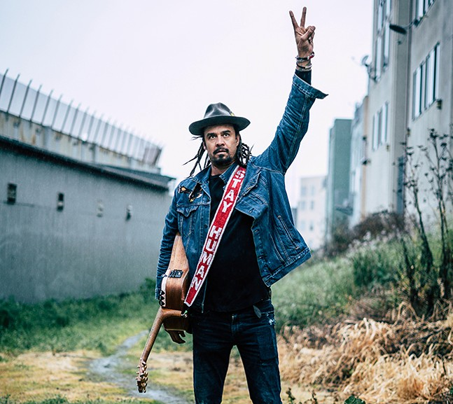 Michael Franti performs at Rock, Reggae & Relief