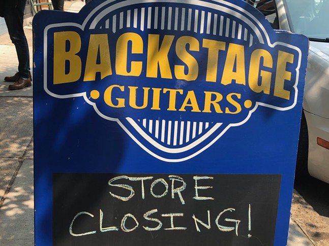Sign in front of Backstage Guitars - JASON COOK