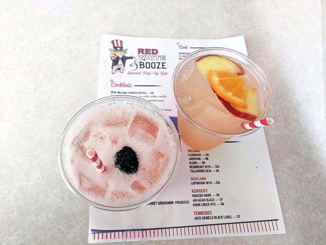 The red rum punch and the white sangria from Red White & Booze - CP PHOTO: MAGGIE WEAVER