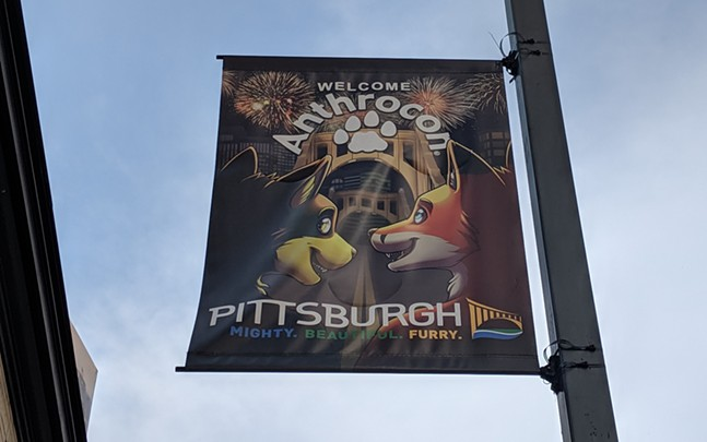 An Anthrocon flag welcomes furries to Pittsburgh on Liberty Avenue in Downtown Pittsburgh. - CP PHOTO: LISA CUNNINGHAM