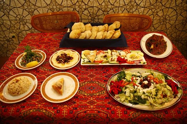 Various dishes including homemade artisan Syrian bread, Tabolli, hummus bi lahme, mazza, mowzat lamb shank, rice, Khalil's signature salad, and desserts - CP PHOTO: JARED WICKERHAM