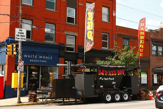 Bad Azz BBQ booth setting up for Little Italy Days - CP PHOTO: JARED WICKERHAM
