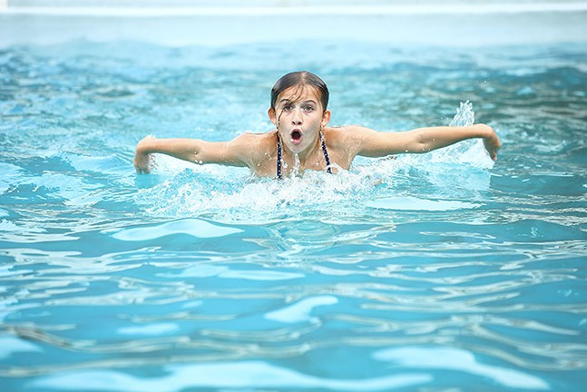 Elyse, 12, practices her fly swim at the Bloomfield pool - CP PHOTO: JARED WICKERHAM