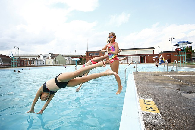 Margeaux (middle) dives into the Bloomfield pool with her friends, Amelia and Sophie - CP PHOTO: JARED WICKERHAM