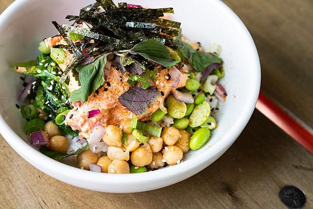 Spicy Tuna Poke Bowl: Edamame, roe, seaweed salad, cucumber, onions, - toasted sesame, soy, sriracha, sriracha mayo, - wasabi, cilantro, shiso, nori, shallot chips, - togarashi - PHOTO: TAYLOR BLOCKSOM