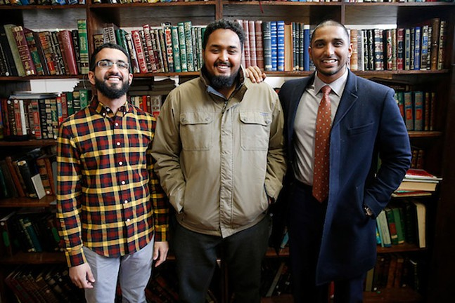 Wasi Mohamed, Executive Director of the Islamic Center of Pittsburgh (right), poses for a portrait with his staff members Mohamed Sajjad (left) and Koshin Yusuf (center) at the Islamic Center of Pittsburgh - CP PHOTO: JARED WICKERHAM