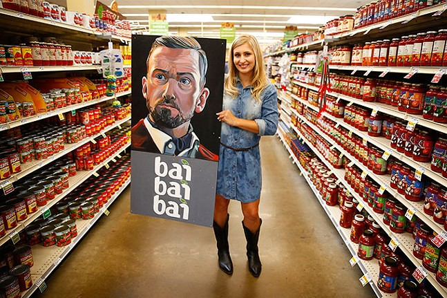 Rachel Dawn Renaudin poses with her Justin Timberlake-inspired artwork at the Giant Eagle Market District in Shadyside. - CP PHOTO: JARED WICKERHAM
