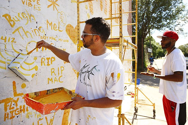 Kyle Holbrook and Warren Jackson at work on the mural - CP PHOTO: JARED WICKERHAM