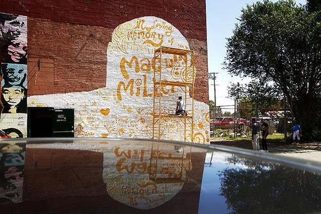 Community members contribute to the Mac Miller mural. - CP PHOTO: JARED WICKERHAM