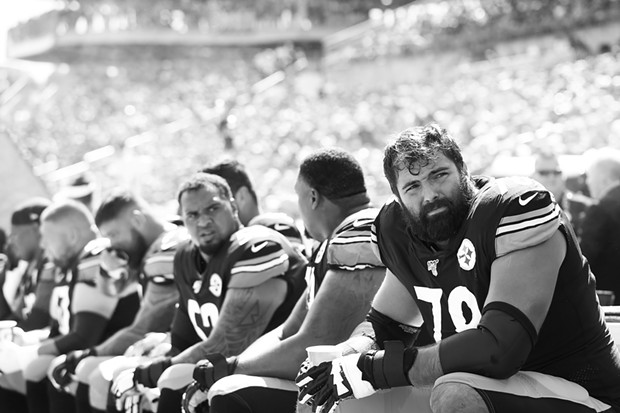 Alejandro Villanueva #78 of the Pittsburgh Steelers sits on the bench in front of the cooling fans. - CP PHOTO: JARED WICKERHAM