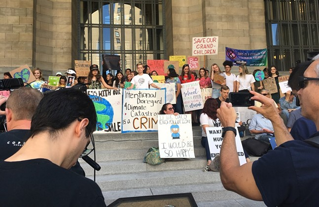 Students gather on the steps of the City-Council Building for the Global Climate Strike in Pittsburgh. - CP PHOTO: AMANDA WALTZ
