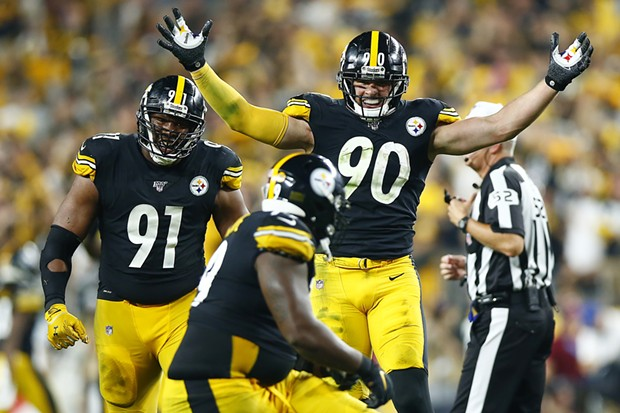 T.J. Watt celebrates a sack by Javon Hargrave. - CP PHOTO: JARED WICKERHAM