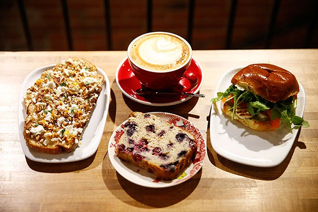 Chevre and fig jam toast, a latte, blueberry banana bread, and halloumi from De Fer Coffee & Tea - CP PHOTO: JARED WICKERHAM