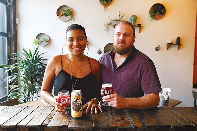 Clara Kent poses for a portrait with her own beer, called Aura, with Travis Tuttle, owner of Butler Brew Works - CP PHOTO: JARED WICKERHAM