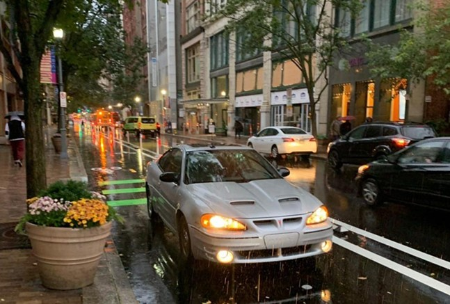 Car parked in Penn Avenue protected bike lane on Oct. 16 - PHOTO: COURTESY OF BIKE PITTSBURGH