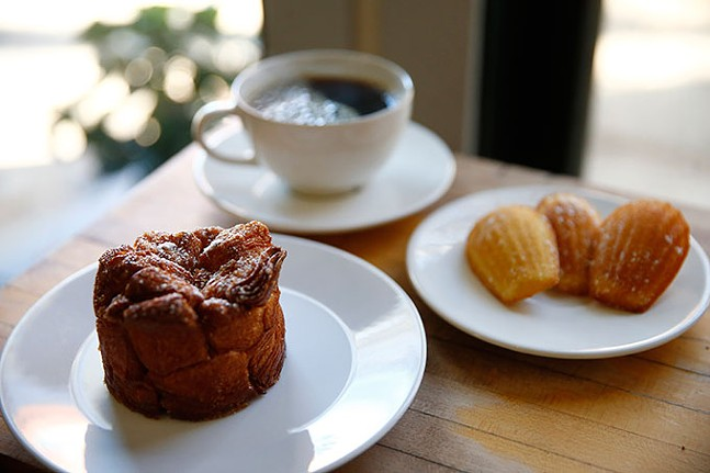 A chai-spiced pull-apart bread, madeleines, and a coffee at Madeleine Bakery & Bistro - CP PHOTO: JARED WICKERHAM