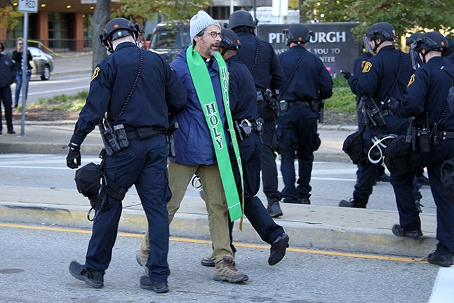 Pittsburgh Police arrest a demonstrator for unlawful protesting during the Solidarity Against White Nationalism rally on Wed., Oct. 23, 2019. - CP PHOTO: JOIE KNOUSE