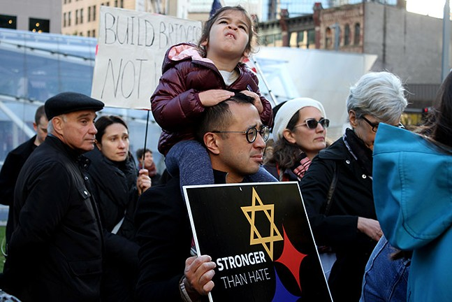 Nathaniel Yap and his daughter participate in Pittsburgh's Bend the Arc's rally - CP PHOTO: JOIE KNOUSE