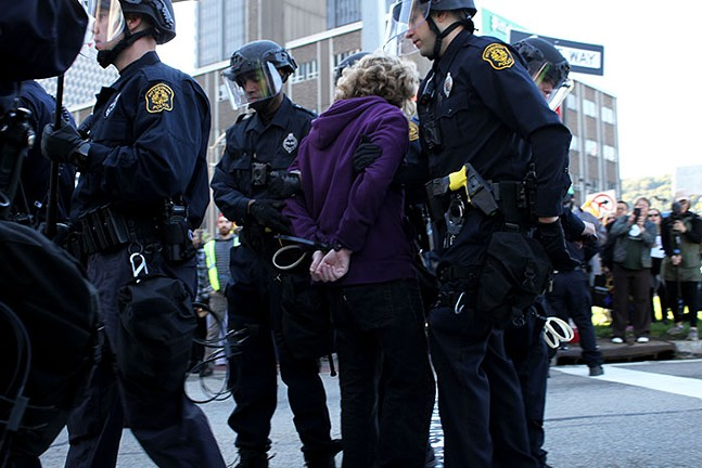 Pittsburgh Police arrest a demonstrator for unlawful protesting. - CP PHOTO: JOIE KNOUSE