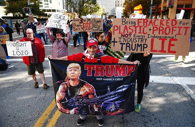 Supporters and protesters gathered in Downtown Pittsburgh during President Trump's visit to the David L. Lawrence Convention Center on Wed., Oct. 23. - CP PHOTO: JARED WICKERHAM
