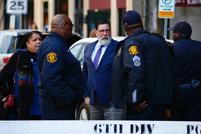 Pittsburgh mayor Bill Peduto speaks to police and protest organizers outside the convention center. - CP PHOTO: JARED WICKERHAM