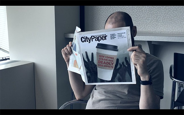 Ben Korman reads a fake Pittsburgh City Paper in Mini Dungeon's short zombie film Jocelyn's Best Day Ever