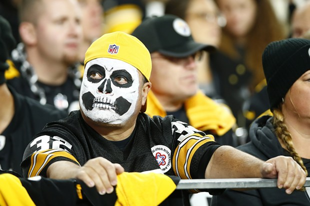 A Pittsburgh Steelers fan dressed up for Halloween looks on during the game. - CP PHOTO: JARED WICKERHAM