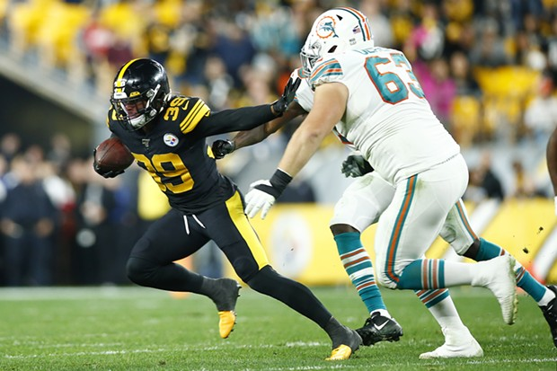 Minkah Fitzpatrick #39 of the Pittsburgh Steelers runs with the ball following the first of two interceptions against his former team. - CP PHOTO: JARED WICKERHAM