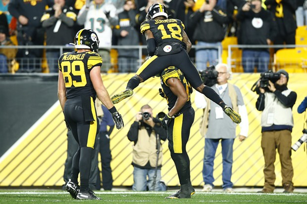 Diontae Johnson #18 of the Pittsburgh Steelers jumps on JuJu Smith-Schuster #19 of the Pittsburgh Steelers following a touchdown. - CP PHOTO: JARED WICKERHAM