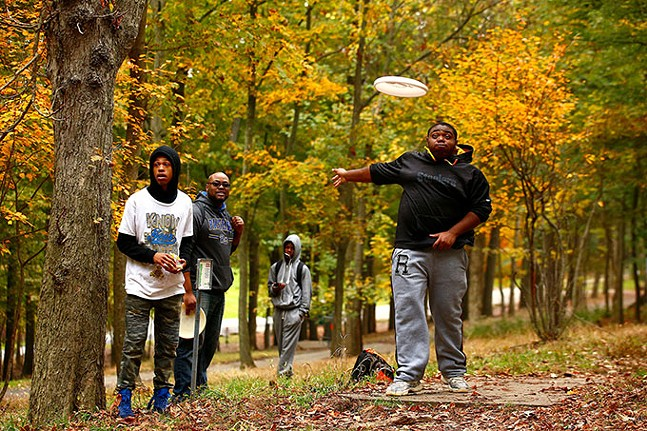 Quinton Moon, 16, throws a frisbee while playing disc golf with his classmates from Propel Andrew Street school while on a field trip at Schenley Park. - CP PHOTO: JARED WICKERHAM