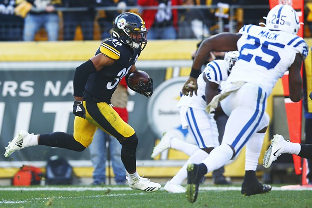 Minkah Fitzpatrick #39 of the Pittsburgh Steelers returns an interception for a 96-yard touchdown. - CP PHOTO: JARED WICKERHAM