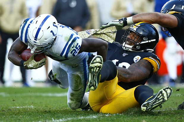 Bud Dupree #48 of the Pittsburgh Steelers tackled Marlon Mack #25 of the Indianapolis Colts. - CP PHOTO: JARED WICKERHAM