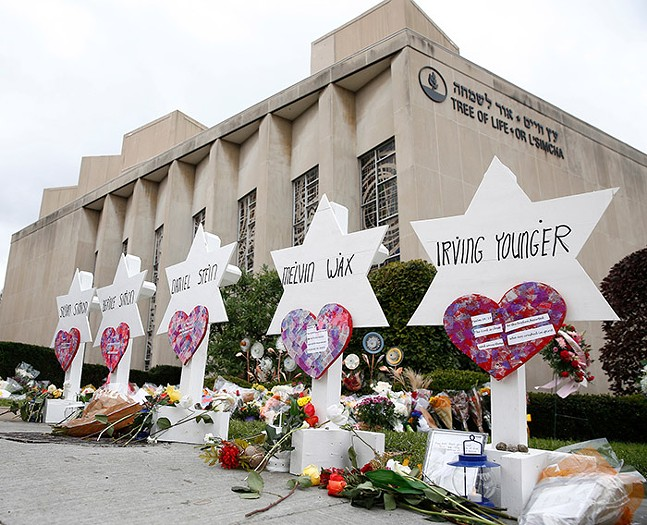 Star of David memorials with the names of the 11 people who were killed at Tree of Life Synagogue, shown outside the Squirrel Hill synagogue on Mon., Oct. 29, 2018 - CP PHOTO: JARED WICKERHAM