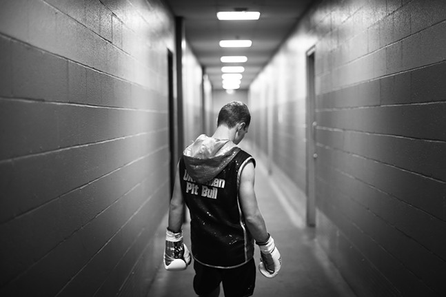 "Oleg ""The Ukrainian Pitbull"" Dovhun of the Conn-Greb boxing club waits in the hallways before his fight on Saturday night at Printscape Arena in Canonsburg. - CP PHOTO: JARED WICKERHAM"