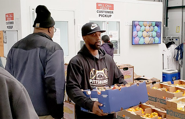 Pittsburgh favorite Andrew McCutchen volunteering in the Strip District - CP PHOTO: JOSH OSWALD