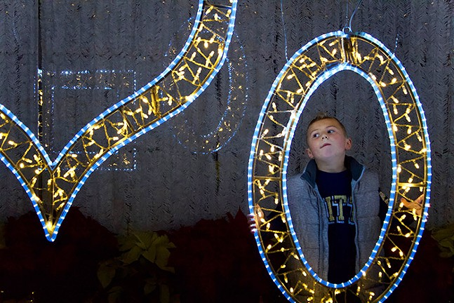 A child poses in one of the light-up picture frames. - CP PHOTO: JOIE KNOUSE