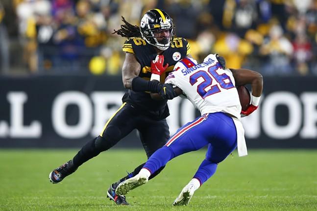 Mark Barron #26 of the Pittsburgh Steelers tackles Devin Singletary #26 of the Buffalo Bills. - CP PHOTO: JARED WICKERHAM