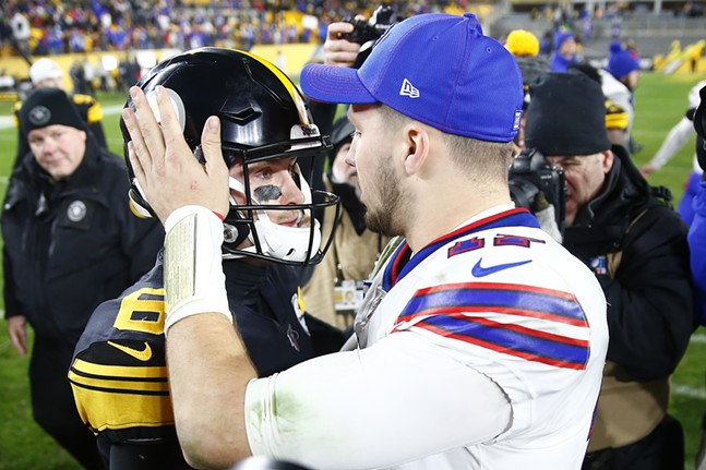 Devlin Hodges #6 of the Pittsburgh Steelers and Josh Allen #17 of the Buffalo Bills talk at midfield following the game. - CP PHOTO: JARED WICKERHAM